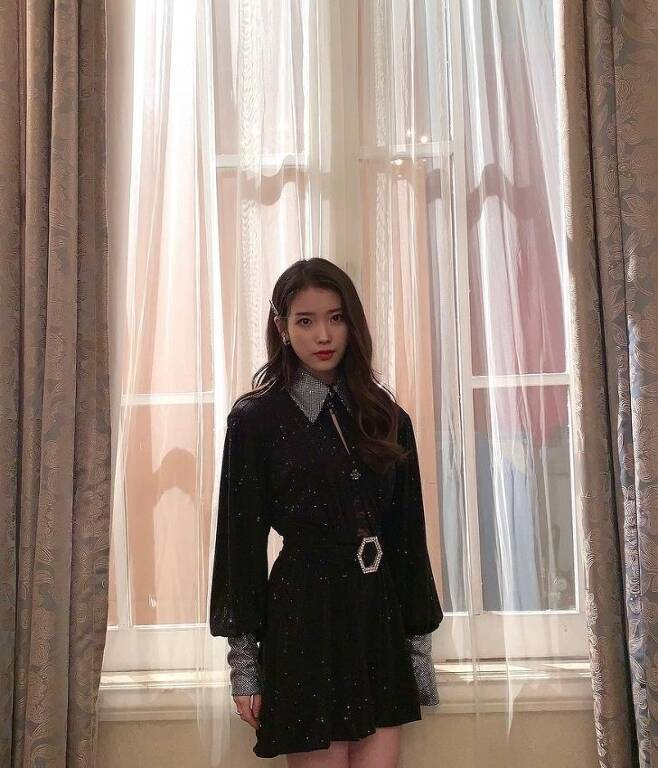 IU (real name Lee Ji-eun) posted several photos on her SNS on Thursday, along with a celebrity hashtag.The photo is a Celebrity special clip video behind-the-scenes cut released on the YouTube Wonder K channel on the 29th.The lovely visuals of the IU, which poses throughout the classic set, catch the eye.The fans who saw the photos responded such as It is light, It was the best live, and This time it is the same.On the other hand, IU announced the regular 5th album Celebrity on the 27th.
